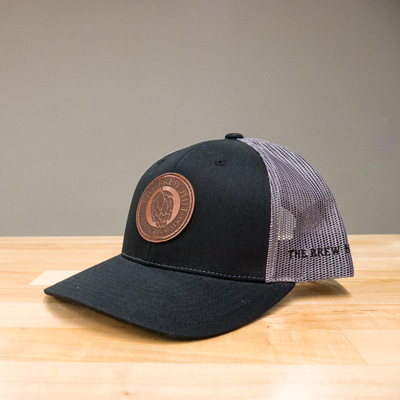 Snap-back Trucker Hat: Logo Patch – Black/Grey
