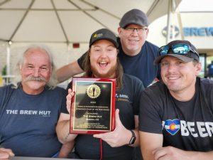 the brew hut staff posing with the homebrew shop of the year award